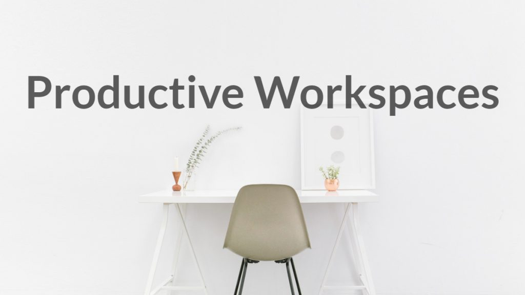 Productive Workspaces text on wall above desk.
